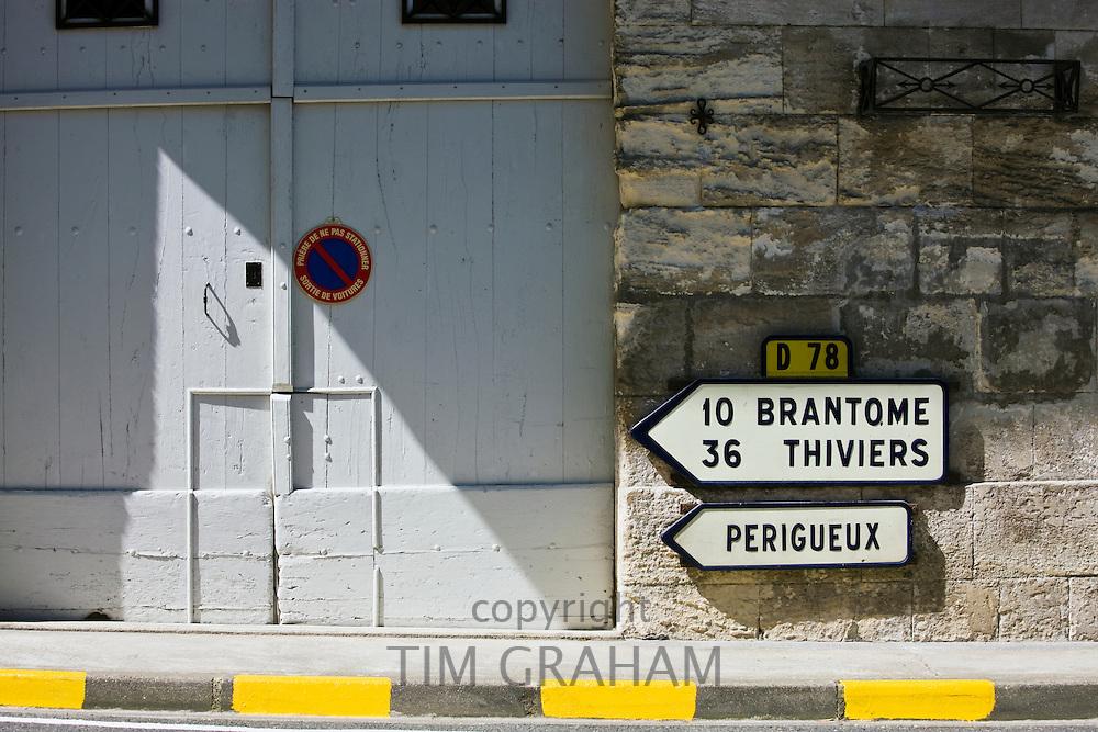 Signpost in town of Bourdeilles popular tourist destination near Brantome in Northern Dordogne, France