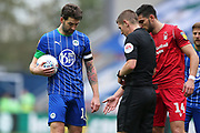 Referee Matthew Donohue shows Wigan Athletic defender Charlie Mulgrew (16) where the free kick has to be taken from during the EFL Sky Bet Championship match between Wigan Athletic and Nottingham Forest at the DW Stadium, Wigan, England on 20 October 2019.