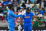 KL Rahul of India and Rohit Sharma of India chat between overs during the ICC Cricket World Cup 2019 match between Bangladesh and India at Edgbaston, Birmingham, United Kingdom on 2 July 2019.