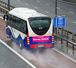 © London News Pictures. 16/07/2012. London, UK. An official Olympics bus travelling on the M4 Olympic lane on July 16, 2012 which opened today. Journeys for Olympic officials and athletes into central London are intended to be eased by the Olympic lane on the M4 motorway, which is the main route in to central London from Heathrow airport. Photo credit: Ben Cawthra/LNP.