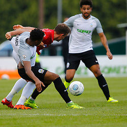 AUGUST 12:  Dover Athletic against Wrexham in Conference Premier at Crabble Stadium in Dover, England. Wrexham's midfielder Sam Wedgbury man handles Dover's forward Kane Richards. (Photo by Matt Bristow/mattbristow.net)