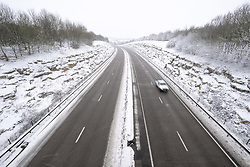 © Licensed to London News Pictures 01/02/2019, Cirencester, UK. After overnight snow in. Cirencester the normally busy A417 with only a few cars travelling in the bad weather. Photo Credit : Stephen Shepherd/LNP