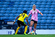 Kirsty Smith (#2) of Scotland looks to take on Den-Den Blackwood (#14) of Jamaica during the International Friendly match between Scotland Women and Jamaica Women at Hampden Park, Glasgow, United Kingdom on 28 May 2019.