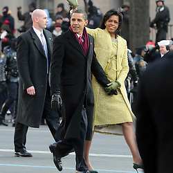 President Barack Obama and First Lady Michelle Obama walk in the inaugural parade down Pennsylvania Avenue in Washington DC.