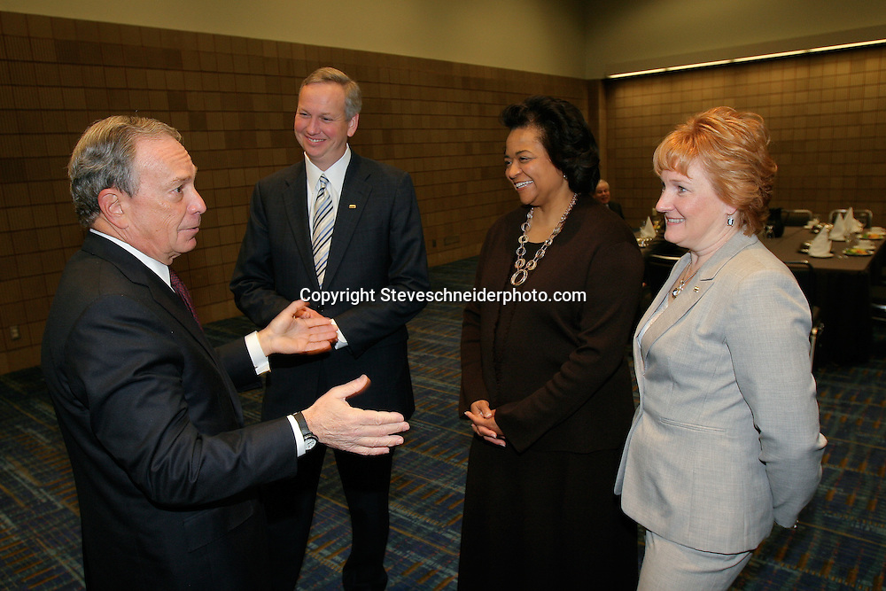 New York City Mayor Michael Bloomberg speaks with officers of the National League of Cities during one of their events in Washington, DC.