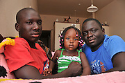 "Tucsonans, Ochana Otto, 17, (left), and Okello Otto, 29, (right), fled Sudan and came to the United States as refugees. Okello's 17-month-old daughter, Emily, was born in the U.S. Ochana, a Tucson High School student, said, ""We are happy to be a part of the Tucson community."" Okello works nights and will attend the University of Arizona to study engineering."