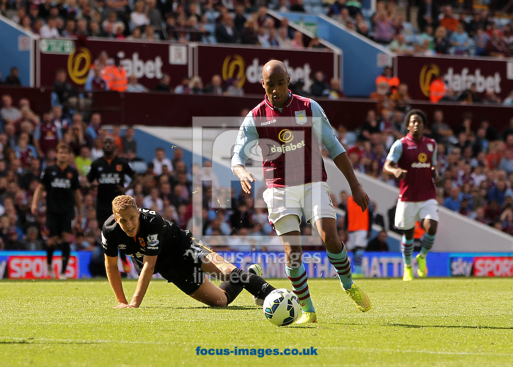 Michael Dawson (centre left) of Hull City watches on as Fabian Delph (centre right) of Aston Villa shapes up to shoot during the Barclays Premier League match at Villa Park, Birmingham<br /> Picture by Tom Smith/Focus Images Ltd 07545141164<br /> 31/08/2014