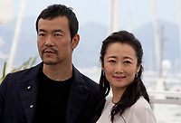 Fan Liao and Tao Zhao at the Ash Is The Purest White (Jiang Hu Er Nv) film photo call at the 71st Cannes Film Festival, Saturday 12th May 2018, Cannes, France. Photo credit: Doreen Kennedy