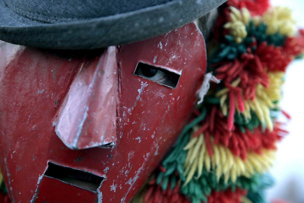 "One ""Careto"" mask in Podence Carnival. Podence is a very small village in Northeast Portugal that  promotes its festivities as the ""most traditional ones"" in the country. Men and boys wear a wool suit that was usually handcrafted by the owner when he was an adolescent and traditionally women were not allowed to participate."