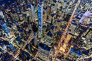 Aerial night view of Midtown Manhattan, New York City, featuring 432 Park Avenue, photographed from a helicopter.