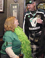 "Jenny Babin (left) from Atkinson, Illinois and Scott Moore, from Xenia talk at the Dublin Pub, Saturday night, March 17th.  Why did she come to the Dublin Pub for St. Patrick's Day?  ""I love men in skirts!"""
