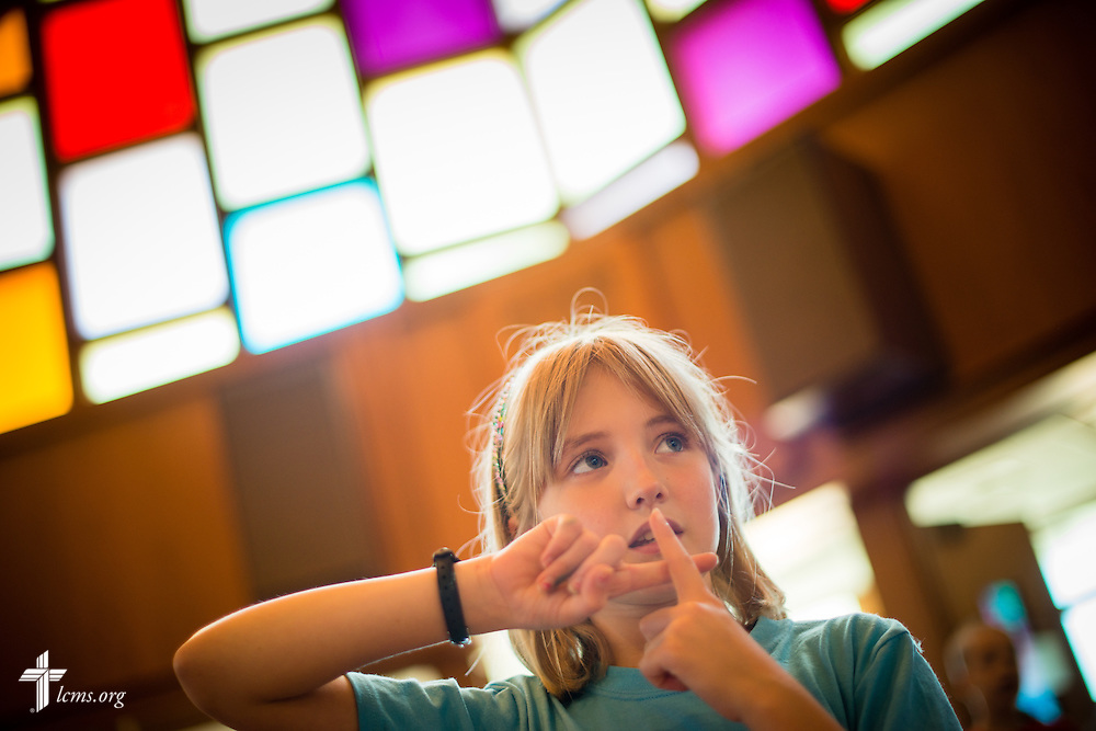 Lexi Hosch sings during Camp Discovery VBS at Our Savior Lutheran Church in Fenton, Mo, on Thursday, June 25, 2015. Cooperation between the Office of International Mission and Our Savior gave the children of new missionaries in orientation the opportunity attend the summer program. LCMS Communications/Erik M. Lunsford