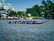 29 OCTOBER 2018 - PHRA PRADAENG, SAMUT PRAKAN, THAILAND: A racing long boat is rowed downriver during the long boat races in Phra Pradaeng. The longboat races go about one kilometer down the Chao Phraya River to the main pier in Phra Pradaeng. The boats are crewed by about 20 oarsmen. Longboat racing traditionally marks the end of the Buddhist Rains Retreat (called Buddhist Lent) in Thai riverside communities.       PHOTO BY JACK KURTZ