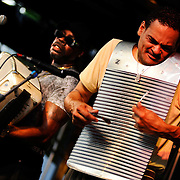 Clifford Alexander, Jr., sweats out the beat on the washboard as Red Hot Louisiana Band leader C.J. Chenier plays the accordion during Friday's Fun Fest Hot New Orleans Night concert on Broad Street.