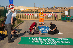 Environmental activists from HS2 Rebellion use a lock-on arm tube to block a gate to the South Portal site for the HS2 high-speed rail link on 14 September 2020 in West Hyde, United Kingdom. Anti-HS2 activists blocked two gates to the same works site for the controversial £106bn rail line, one remaining closed for over six hours and another for over twelve hours.