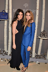 Left to right, GALA GORDON and CARA DELEVINGNE at a Dinner to celebrate the launch of the Mulberry Cara Delevingne Collection held at Claridge's, Brook Street, London on 16th February 2014.