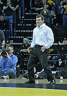 January 07, 2011: Iowa head coach Tom Brands motions to his player during the 133-pound bout in the NCAA wrestling dual between the Oklahoma State Cowboys and the Iowa Hawkeyes at Carver-Hawkeye Arena in Iowa City, Iowa on Saturday, January 7, 2012. Ramos won 4-3.