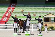 Podium Grand Prix 1. Gareth Hughes - DV Stenkjers Nadonna, 2. Carl Hester - Nip Tuck, 3. Nathalie zu Sayn Wittgenstein - Fabienne<br /> Test Event WEG Normandie 2014<br /> © DigiShots