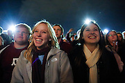 Bailey Nance, left, and Taylor Benson sing Aggie Songs with thousands of other Texas A&M Aggie fans at Stockyards Station during the pre-Cotton Bowl midnight Aggie Yell practice in Fort Worth, Texas, on January 4, 2012.  (Stan Olszewski/The Dallas Morning News)