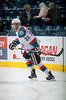KELOWNA, CANADA - MARCH 7: Devante Stephens #21 of Kelowna Rockets warms up against the Spokane Chiefs on March 7, 2015 at Prospera Place in Kelowna, British Columbia, Canada.  (Photo by Marissa Baecker/Shoot the Breeze)  *** Local Caption *** Devante Stephens;