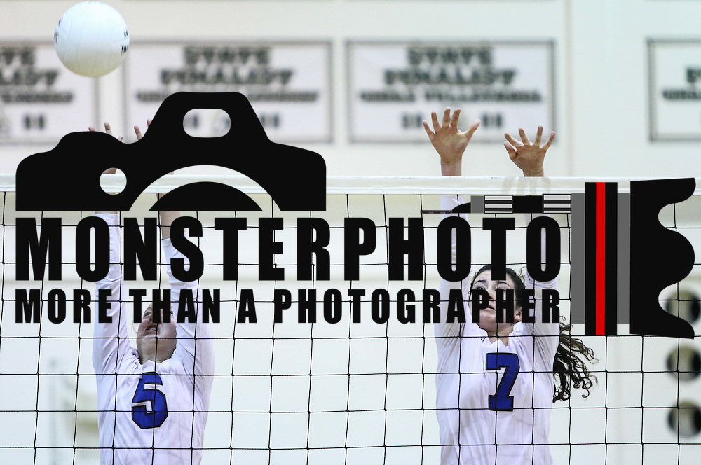 Charter Rileigh Hudock (5) and Annika Sernyak (7) attempts to block a spike during the 2nd Round of the 2015 DIAA Girls Volleyball Tournament Saturday, Nov. 07, 2015 at Archmere Academy in Claymont.