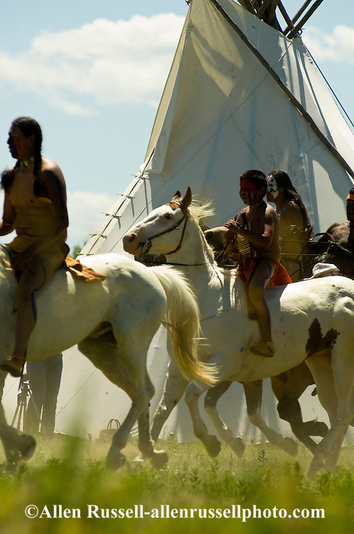 Custer's Last Stand Reenactment; Battle of the Little Bighorn; Crow Indian Reservation; Montana; warriors ride to attack General George Custer, Seventh Cavalry.