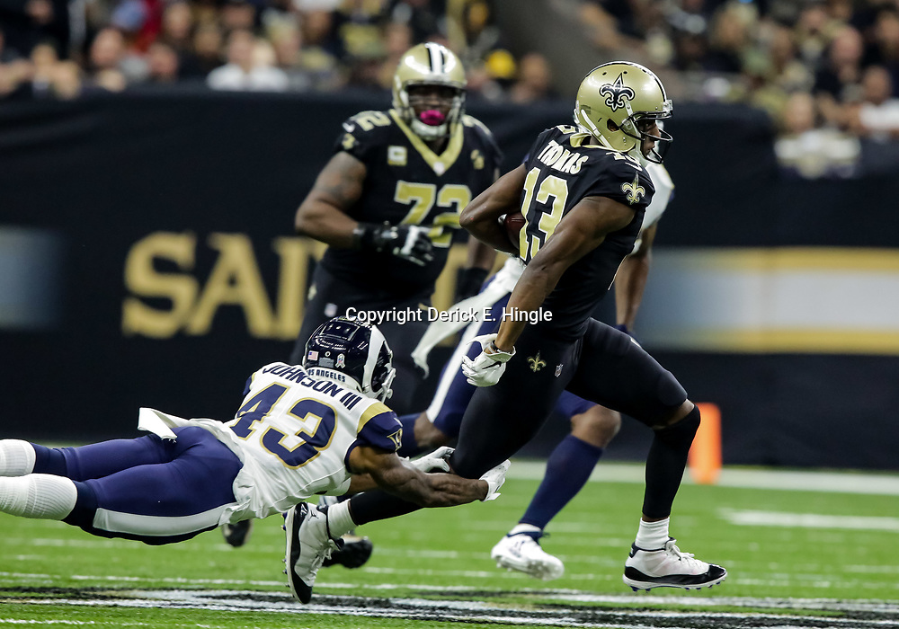 Nov 4, 2018; New Orleans, LA, USA; New Orleans Saints wide receiver Michael Thomas (13) breaks a tackle attempt by Los Angeles Rams strong safety John Johnson (43) during the first half at the Mercedes-Benz Superdome. Mandatory Credit: Derick E. Hingle-USA TODAY Sports