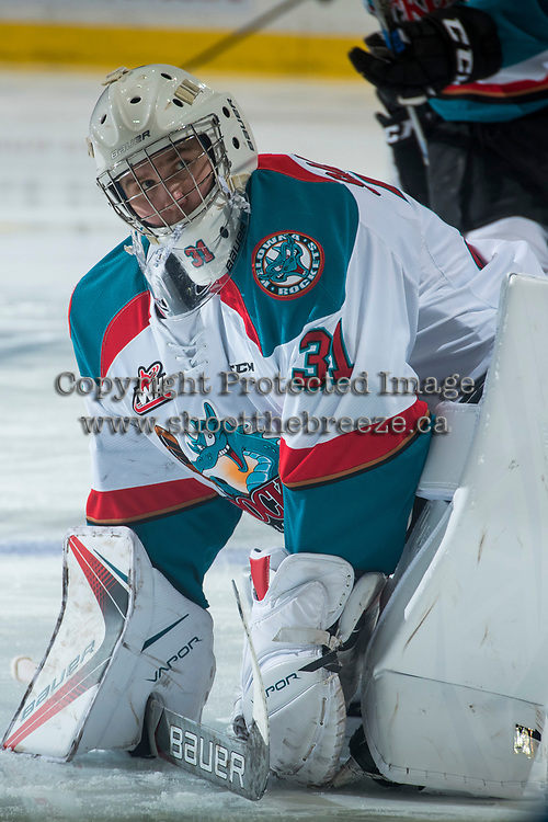 KELOWNA, CANADA - MARCH 25: Brodan Salmond #31 of the Kelowna Rockets stretches on the ice during warm up against the Kamloops Blazers on March 25, 2017 at Prospera Place in Kelowna, British Columbia, Canada.  (Photo by Marissa Baecker/Shoot the Breeze)  *** Local Caption ***