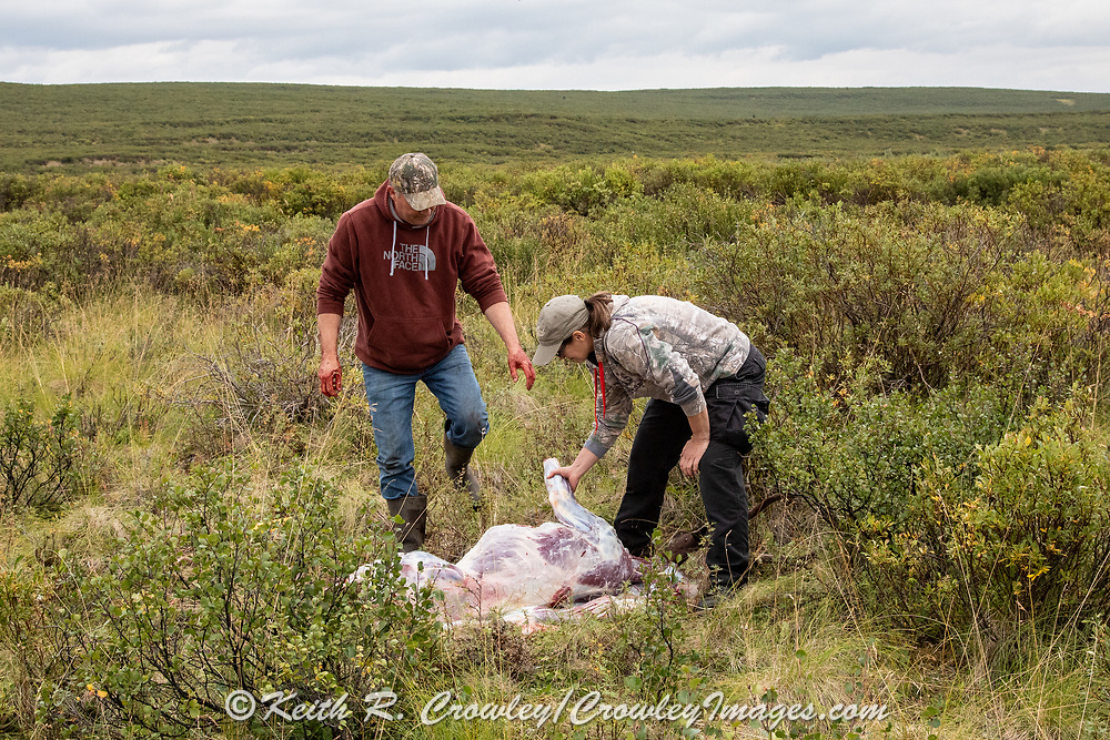 Heidi Anderson and Bernie McGowan field dress a caribou during Heidi's 2019 subsistence hunt in Alaska.