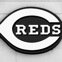 Cincinnati Reds sign black and white picture on the Great American Ball Park stadium wall. The Cincinnati Reds are the Major League Baseball (MLB) team for Cincinnati, Ohio and were established in 1881. Photo Copyright © 2012 Paul Velgos with All Rights Reserved.