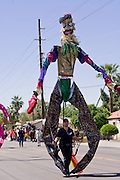 14 APRIL 2007 -- PHOENIX, AZ: A man with an 18 foot tall puppet walks in the annual Gay Pride Parade in Phoenix, AZ. Thousands of people attended the annual event.  Photo by Jack Kurtz / ZUMA Press