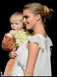 Cara Delevingne arriving at the wedding of Poppy Delevingne to James Cook at St.Paul's Church in Knightsbridge, London,  Friday, 16th May 2014. Picture by Stephen Lock / i-Images