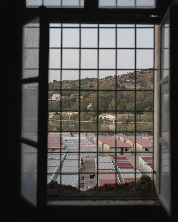 The First Reception Centre (Hot-Spot) of Leros, seen through a window the former Psychiatric Hospital. There are around 600 people living there. Since the July riots the camp has been split into different zones for the different ethnicities.  <br />