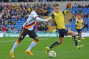 Bradford City midfielder Mark Marshall (7) about to shoot at goal watched by Oxford United midfielder Joshua Ruffels (14) 0-0 during the EFL Sky Bet League 1 match between Oxford United and Bradford City at the Kassam Stadium, Oxford, England on 15 October 2016. Photo by Alan Franklin.