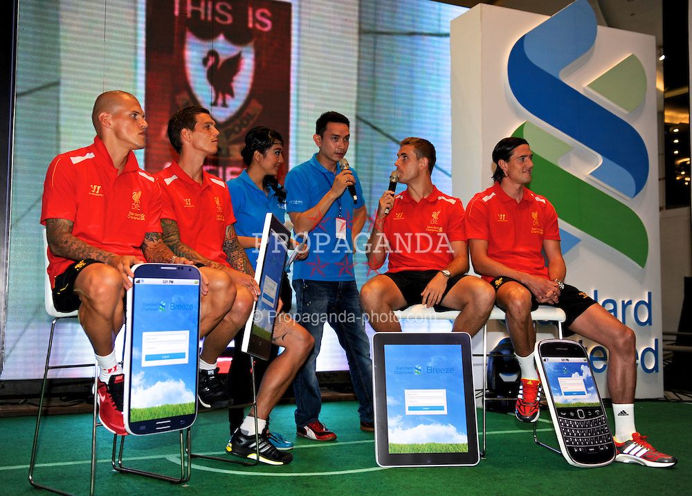 JAKARTA, INDONESIA - Friday, July 19, 2013: Liverpool's Martin Skrtel, Daniel Agger, Jordan Henderson and Martin Kelly at a fans' event at the FX Senayan Centre during the side's visit to Indonesia as part of their Preseason Tour. (Pic by David Rawcliffe/Propaganda)