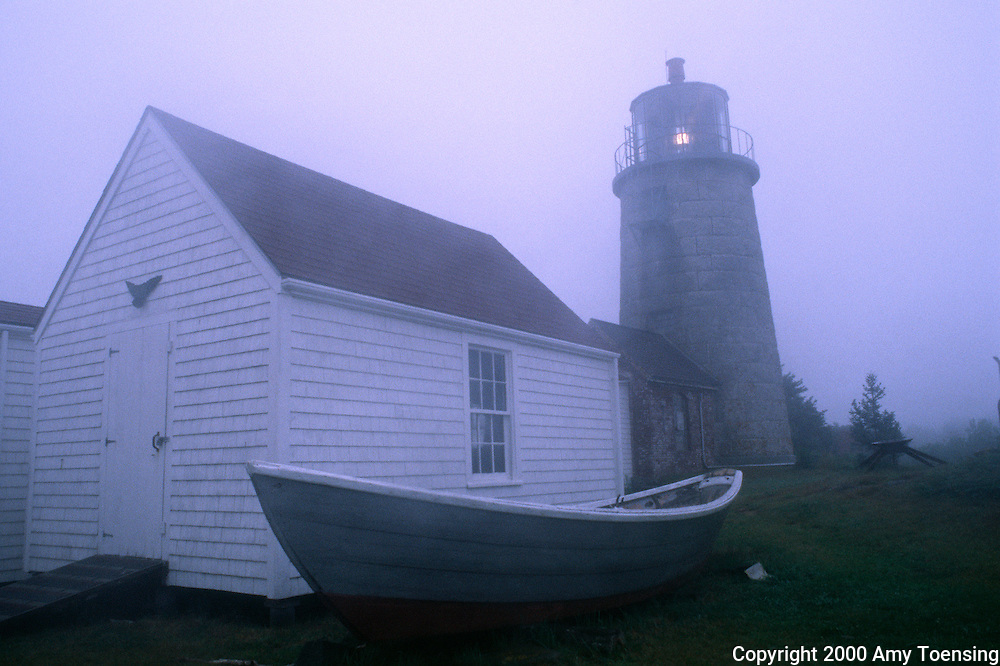MONHEGAN ISLAND, MAINE - JULY 28: Fog rolls in around the lighthouse July 28, 2000 on Monhegan Island, Maine. Monhegan Island, home to lobstermen and painters and a popular destination for tourists is twelve miles off the coast of Maine. Ringed by high, dark cliffs, its interior a mix of meadows, marsh and spruce groves, Monhegan is one of just 14 true island communities left off the coast of Maine. The island has a 65 permanent, year-round residents and the population grows to around 200 in the summer, with day-trippers adding several hundred more. (Photo by Amy Toensing) _________________________________________<br />
