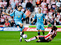 Photo: Alan Crowhurst.<br />Southampton v Sunderland. Coca Cola Championship. 09/04/2007. Sunderland's Carlos Edwards (L) challenges Alexander Ostlund.