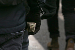 19 January 2019. Paris, France.<br /> Gilets Jaunes - Acte X take to the streets of Paris. A young man picks up a piece of broken concrete along the route ready to throw at the CRS riot police at the end of the demonstration. An estimated 7,000 people took part in the looping 14 km route from Place des Invalides to protest tax hikes from the Government of Emmanuel Macron imposed on the people. An estimated 80,000 people took part in protests across the country. Regrettably the movement has attracted a violent element of agitators who often face off with riot police at the end of the marches which tends to deflect attention away from the message of the vast majority of peaceful protesters.<br /> Photo©; Charlie Varley/varleypix.com