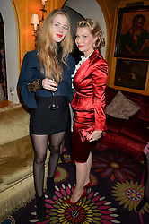 Left to right, HANNAH GEORGE and her mother GEORGIANA GEORGE at an exclusive dinner for Iris Apfel held at Annabel's, Berkeley Square, London on 29th July 2015.