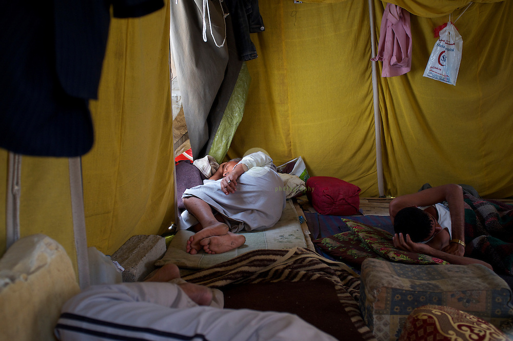 Turmoil in Yemen: ASIA, YEMEN, SANA, 20.06.2011: Anti-government protesters holding a mid-day nap in their tent. For months, protesters of all colors have been staying in tents at Change Square, demanding the resignation of President Ali Abdullah Saleh and an end to his regime.