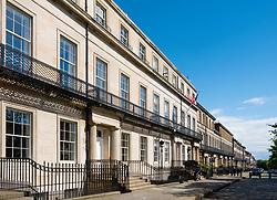 View of townhouses on historic Regent Terrace  below Calton Hill in Edinburgh, Scotland, United Kingdom