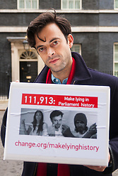 "Downing Street, London, January 7th 2015. TV star 2015-01-07 TV star Jolyon Rubinstein delivers a ""Make Lying in Parliament History"" petition with 111,913 signatures to 10 Downing Street. The petition aims ""to start a debate about the importance of the truth in politics"" and comes off the back of his satirical TV show The Revolution Will be Televised which has been "" highlighting the corruption, greed and hypocrisy in our system"" and wants to make lying in Parliament a criminal offence. PICTURED: Jolyon Rubinstein prepares to deliver the petition."
