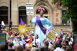© Licensed to London News Pictures . 17/06/2018. Manchester , UK . Stonewall and Trans Rights campaigners . The 2018 Manchester Day parade , celebrating Manchester's cultural and social life and diversity, passes through Manchester City Centre . Photo credit : Joel Goodman/LNP