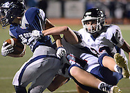 Central Bucks East's Tyler Tracy (21) tackles Council Rock North's Michael Welde (28) in the first quarter at Council Rock North Saturday October 15, 2016 in Newtown, Pennsylvania.  (Photo by William Thomas Cain)