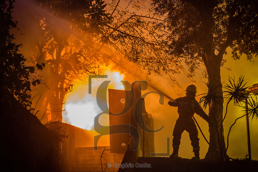 A fireman hoses a fire in the city of Funchal, Madeira island, Portugal, 10 August 2016. Wild fires on the Madeira island have destroyed several buildings in the capital and reportedly killing at least three people. EPA/GREGORIO CUNHA