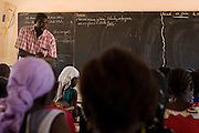 A teacher addresses students during class at the Tangory Transgambienne 2 primary school in the town of Bignona, Senegal on Wednesday June 13, 2007.
