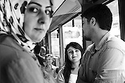 Young people inside a bus in Istanbul.