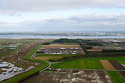 Nederland, Zeeland, Zeeuws-Vlaanderen, 23-10-2013; Van rechts naar links onder in beeld: Belgische Prosperpolder en reeds onder water gezet, daarnaast De Hedwige Polder en tenslotte Het Verdronken Land van Saeftinge. Aan de horizon de Belgische kant van de Westerschelde naar de Haven van Antwerpen. <br /> Borderland Belgium and the Netherlands, the Drowned Land Saeftinge (l) and the Belgian polder (right), under water due to environmental compensation. Westerschelde end entrance of the port of Antwerp on the horizon.<br /> <br /> luchtfoto (toeslag op standaard tarieven);<br /> aerial photo (additional fee required);<br /> copyright foto/photo Siebe Swart.