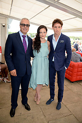 Left to right, JON ZAMMETT, LARA PULVER and EDDIE REDMAYNE at the Audi International Polo at Guards Polo Windsor Great Park, Egham, Surrey on 28th July 2013.