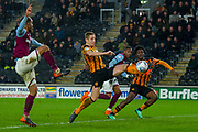 Michael Dawson of Hull City gets a foot onto the cross from Aston Villa Midfielder Ahmed Elmohamady during the EFL Sky Bet Championship match between Hull City and Aston Villa at the KCOM Stadium, Kingston upon Hull, England on 31 March 2018. Picture by Craig Zadoroznyj.